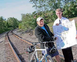 From left to right: Metro Parks Board Member, Dave Ambrose, and Trumbull County Planner Jonathan Millea say they have 4 phases left in Trumbull County and are hopeful that the bike trails will be done in three to five years in this area.