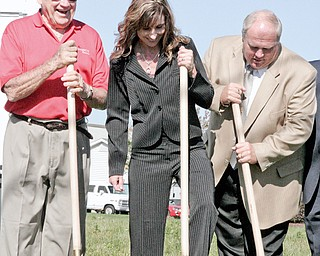 From left to right, Compco Land Chairman of the Board, Clarence Smith of Boardman, Compco's Chief Operating Officer, Becky Andino and Owner of Hively Construction, Lee Hively, break ground on Friday for their project in Boardman.