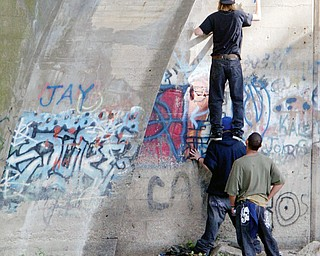 """FINAL WORDS TO A FRIEND: Unidentified youths spray paint """"R.I.P JAY"""" on the Girard/McDonald underpass near where 12-year-old Jamel Smith of Girard drowned Monday. The young people painted the structure Wednesday. Jamel was a seventh-grader at Girard Middle School"""