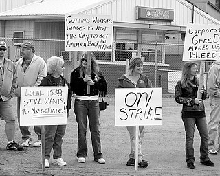 ON THE LINE: Workers at American Standard Brands in Salem began to picket about 1 p.m. Friday over proposed cuts the company wants to make.