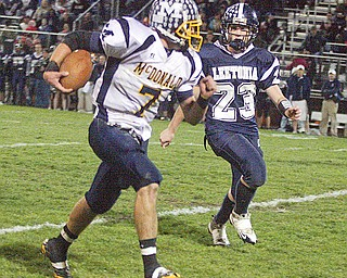 LEETONIA - MCDONALD - (23) Seth McNally of Leetonia tries to track down (7) Mike Thomas after a big gain during their game Friday night at Leetonia.