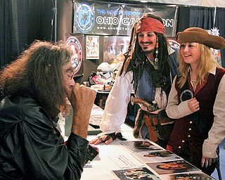 L-R Peter Mayhew (Chewbacca) talks with fans Rodger Dobry and Deanna Watkins. (of Lake Erie Pirates costume organization). The pirates traveled from Erie, PA to attend the Screaming Tiki Comic and Pop Culture Convention.