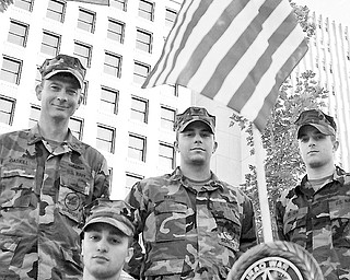 L-R UT1 Richard Gaskill, BUCA Alfonso Sierra III, BU3 Travis Ware and CECN  Kevin Miller stand at attention after completing their memorial to several wars in the downtown square. Saturday October 19, 2008. Daniel C. Britt.