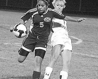 HOWLAND - FITCH -  (5) Sara Ford of Fitch gets tangled up with (1) Tyler Nicholas during their game Monday night in Howland.