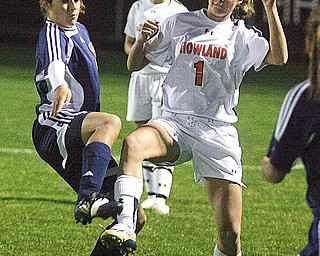 HOWLAND - FITCH -  (6) Tori Koch of Fitch battles (1) Tyler Nicholas for the ball during their game Monday night in Howland.