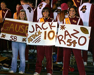 """""""Homecoming Queen Chelsie Leeson and fellow band members Kayla Proverbs and Toni Geffert cheer on the Raider Football team Friday night."""""""