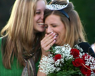 """""""Last year's homecoming queen, Ashley Neimi, and this year's homecoming queen, Chelsie Leeson, share a moment during the crowning ceremony."""""""