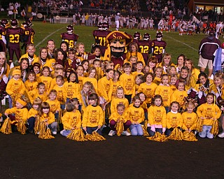 """""""South Range Cheerleaders held an Elementary Cheer Camp last week. The Elementary cheerleaders pose with the Raider Mascot during their performance during the game Friday night."""""""