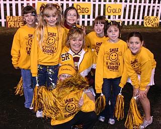"""Varsity Cheerleader Tizzy Baytos poses with several of her 3rd grade cheerleaders Friday night."""