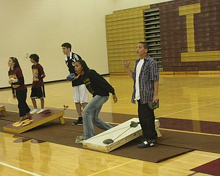 The Liberty Leopards enjoy themselves after the Hubbard game by competing in a Corn Hole Tournament at the End Zone Party