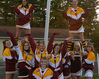 """""""SOuth Range cheerleaders show off the flaming goalposts on """"let's get fired up night"""" Friday evening."""""""
