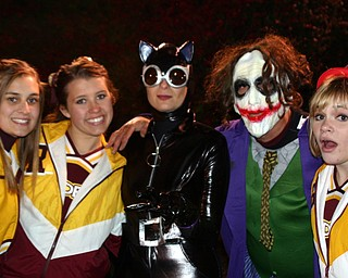 """""""The Joker and Catwoman paid a visit during the South Range band show Friday night and requested a picture with cheerleaders Cheyenne Sears, Jesse Heck, and Tizzy Baytos."""""""