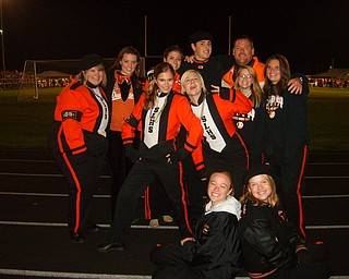 The Springfield Marching Band seniors and director Matt Ferraro prepare for their last home game against Crestview.