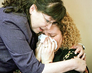 FRIEND'S COMFORT: Penny Sergeff of Ashtabula, a friend of Gina Tenney's, breaks into tears after the guilty verdict was read in the aggravated- murder trial of Bennie Adams. She is hugged by Gina's sister, Rhonda Tenney Gliva.