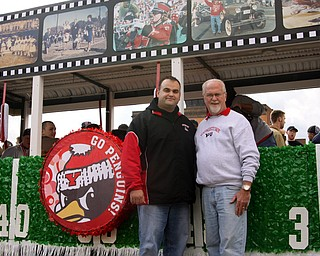 John Young and John Young! Father and son, are both alumni of YSU are standing in front of the Sigma Chi float that the son made.