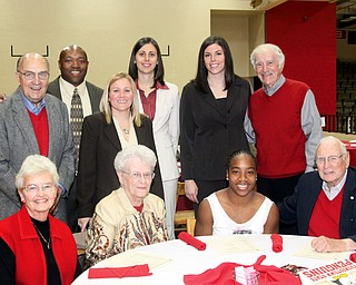 Some members of the Women's Basketball Staff (current and retired) pose with booster members.