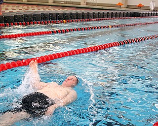 Brian Carney, 40, swims in the 100M Backstroke from Trumbull Fairhaven in the 5th annual Special Olympics swim meet in memory of Kelly Jo Carlson.