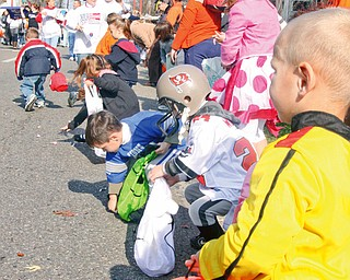 James Edison (3) on far right and many other children collect pieces of candy thrown to them at the parade in Niles Sunday October 26, 2008