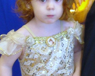 """I would smile, but my mouth is full of candy!""  This is Alyse Murphy, age 2, dressed as a Golden Princess on Oct. 19t at the Parents of Allergic Kids Halloween Party. She is the daugher of Theresa and Kevin Murphy of Cortland."