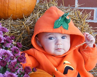 Katie Lynn Dance, 6 months, is dressed up in her little pumpkin outfit, ready for Halloween. She's the daughter of Bob and Terri Dance of Salem.
