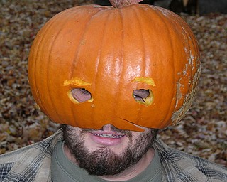 "Mike Fox Jr. of Poland Township, aka ""Mike-O-Lantern,"" has his carved-out pumpkin on his head.  His mom, Laurie Fox, submitted the photo."