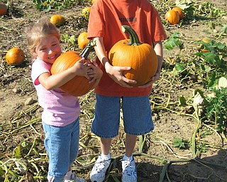 The pumpkin patch at Detwiler Farms is an annual family tradition.  Here is Michaela and Matthew Pinciaro holding the pumpkins they have chosen this year.  Their parents are Michael and Michelle Pinciaro of Salem.