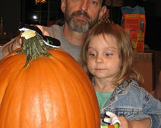 Marty Kish of Springfield Township sent this photo of his daughter, Katherine Kish, putting some silly/scary decorations on a pumpkin with his brother, Jim Hunsberger, of Raleigh, N.C.