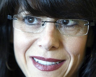 Cynthia Tareshawty of Youngstown sports a pair of Sarah Palin glasses.