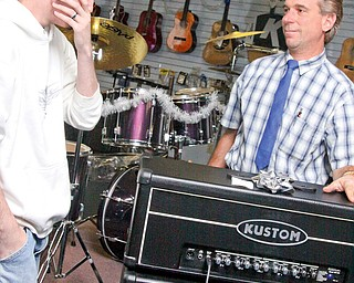 15 year old Gage Markley, left, of Champion gets another surprise. Frank Fordeley gives Gage the Kustom amplifier for beating leukemia.