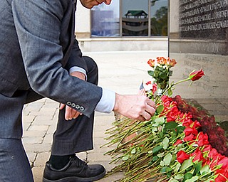 George Otto, service officer for the American Legion who specializes in Veterans Mental Health, lays a rose for a local soldier killed or missing-in-action in the Vietnam War at the VIetnam War Memorial in the Federal Plaza Sunday, November 2, 2008. Daniel C. Britt.