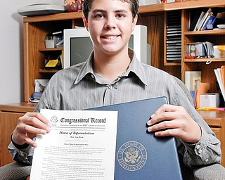 """Brock DeAngelo holds up a copy of the """"Congressional Record"""" of the Childen's Bill of Rights"""""""