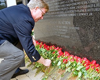 Barry Landgraver, Executive Director of the Veterans Service Commission lays a rose for a local soldier killed or missing-in-action in the Vietnam War at the VIetnam War Memorial in the Federal Plaza Sunday, November 2, 2008. Daniel C. Britt.