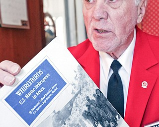 READ ALL ABOUT IT: Marine veteran Richard Mitchells Sr. shows a book about the helicopters on which he was an aircraft electrician.