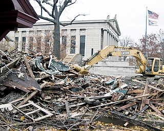 SITE IMPROVEMENT: Rubble is all that's left of a house on Fifth Avenue at Park Street on Youngstown's North Side. Seven dilapidated and boarded-up buildings are finally coming down. City officials refused to wait any longer for the buildings to be demolished; they had been vacant for two years.