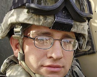 SPC E4 Joshua J.  Bentley HH C1-21 IN BN Camp Liberty, Iraq APO AE 09344 Serving as a gunner on a mine roller in Iraq. Attended Austintown Fitch High School. Resident of Columbiana. Son of Karen and Laura Bentley-Davis, also of Columbiana.