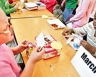 Girard Intermediate School 4th graders Becca Deal, left, and Khadejah Davidson during mix it up day lunch program. Students sat with students with same month birthdays.