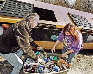 PITCHING IN --- Paul and Mary Bires of Austintown regularly stop and recycle as they bring in three containers of recyclables to the Austintown Recycling Center on Raccoon Rd.