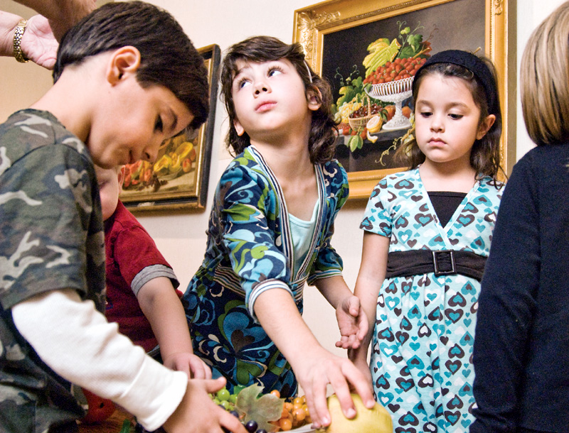 Nico Mascarella, 6, his sister Amelia, 8, both of Youngstown; and Carlee Gaca, 9, of Austintown get a hands-on lesson in still life amid more famous works at the Butler Museum of American Art Children's Day.