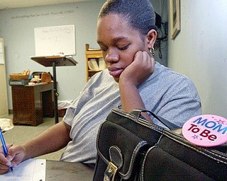 Toni Clark of Youngstown, a client at Pregnancy Help Center in Boardman works on a project during a parenting class.