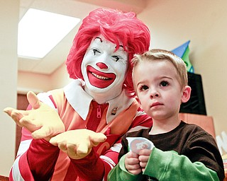 SMILE: Iconic fast-food character Ronald McDonald shares a moment with Len Finsen at the Children's Rehabilitation Center in Howland. Ronald stopped Monday at the center with his pals, the owners of McDonald's restaurants in the Mahoning Valley, to raise awareness about fundraising efforts.