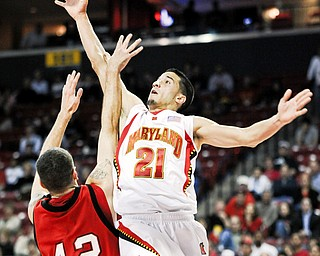 Maryland's Greivis Vasquez shoots against Youngstown State's Dallas Blocker in the first half of a NCAA college basketball game Tuesday, Nov. 18, 2008 in College Park, Md.