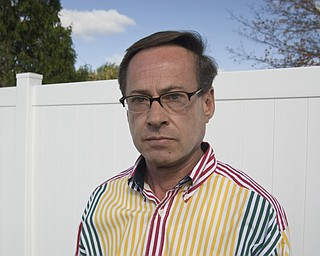 Bill Bogan, a gay, Caucasian male, and outspoken advocate of AIDS/HIV awareness, stands near the high white fence that separates his yard from his neighbors in Struthers. Since he was diagnosed with HIV in the mid-nineties, Bill said he has come face to face with the stigma attached to the disease continually. First, when he was fired after his employer found out what his prescriptions were for and, most recently, while working in his backyard. Bill said he heard his neighbors discuss how their property values will sink as a result of his status. 