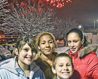 Clockwise from left, Sharonites Alex Cicone, 12, Niyahsa Justice, 12, Laquanda Teague, 13 and Tristen Delgross, 9, turn from the fireworks just long enough to pose for a picture. Light-up Sharon, West State Street downtown.