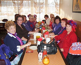 """The Lavish Ladies in Red, a Red Hat Society group, are preparing a special """"red hat"""" card to Deana Soffos, the daughter of one of the  members."""