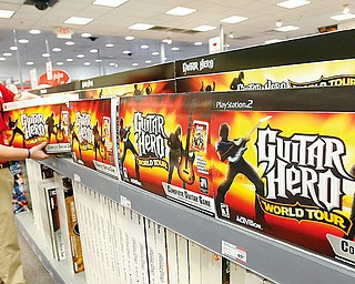 HERO -   Mark Beverly a sales associate at Circuit City in Boardman stocks the shelves with Guitar Hero - a popular game for those brave enough for Black Friday