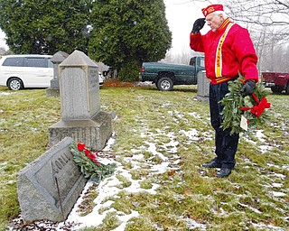 SALUTE - Richard Mitchells of Greenford and the Marine Corps Leauge  lays a wreath and paused a minute to honor the deceased war vet - as 27 Christmas wreaths were placed on the gravestones of 27 veterans in Zion Lutheran Cemetery  in Boardman to honor those who gave their lives while serving in the armed forces.