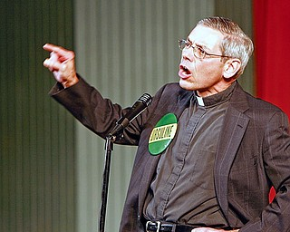 """If you don't get us a day off Monday, you're in real hot water,"""" Father Kenneth Miller, associate principal and a 1964 Ursuline alumnus, warned the team during the rally, picking up the Bishop's theme."""