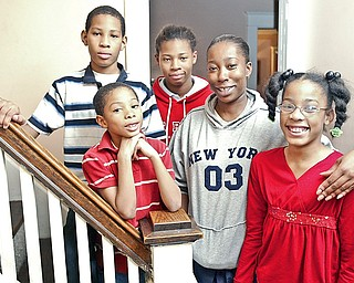 Tiki Davis. a recipient of a holiday gift card from a Hollywood producer, with her children in their Northside Youngstown home. Kids from left are:  Laekwon Brown, 11, Louis Brown, 7, Aaliyah Brown. 13 and Catera Brown, 10.