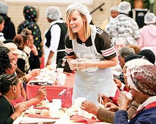 Caitlyn Keck a senior at Jackson Milton high school and from North Jackson - not only served drinks and helped the people but talked with the families to give them that welcome feel - at the Salvation Army Thanksgiving in Youngstown