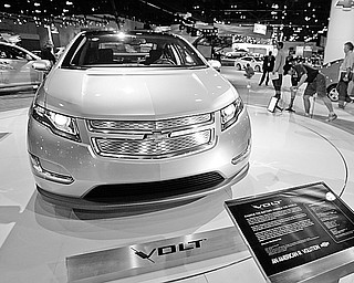 The Chevrolet Volt all-electric concept car is seen on display at the GM exhibit during media previews for the Los Angeles Auto Show Wednesday, Nov. 19, 2008.  The show opens to the public Friday, Nov. 21.